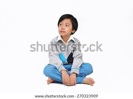 Cute Asian boy model posing in casual wear - stock photo