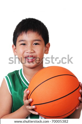cute asian boy playing basketball in white background - stock photo
