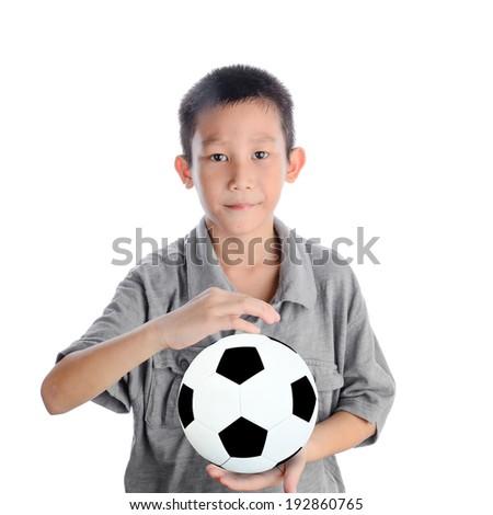 Cute Asian boy playing football, happy child,   - stock photo