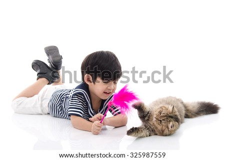 Cute asian boy playing with tabby kitten on white background isolated - stock photo