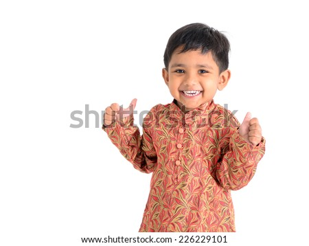 Cute asian boy raised his thumbs up - stock photo