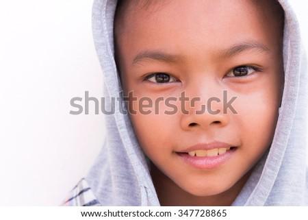 Cute Asian boy wearing hooded sweatshirt. Isolated on white. - stock photo