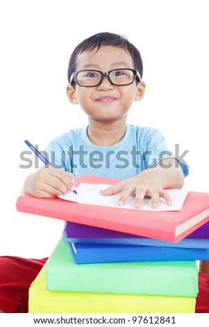 Cute Asian boy with glasses studying shot in studio isolated on white - stock photo