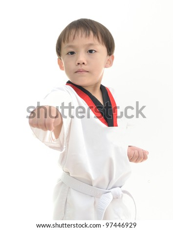 Cute asian boy with taekwondo uniform on white background.