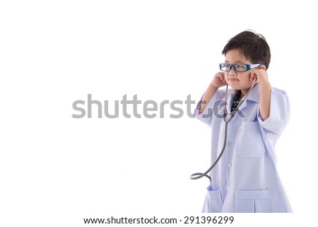 Cute asian child in a doctors uniform on white background isolated with copy space