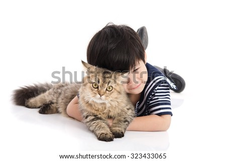Cute asian child lying with tabby cat on white background isolated - stock photo