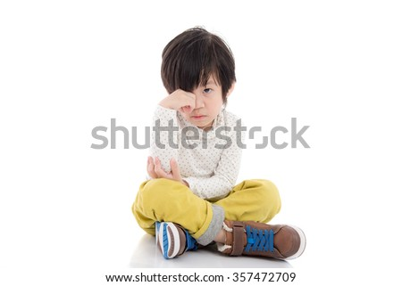 Cute asian child sitting on white background isolated