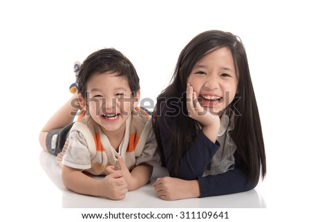 Cute asian children lying on white background isolated - stock photo