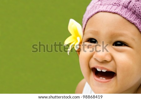 cute asian ethnic toddler girl laughing