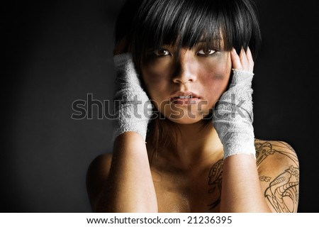 Cute Asian girl covered in dirt and grease - stock photo