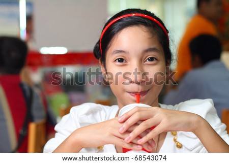 cute asian girl drinking a soda - stock photo