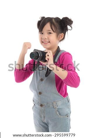 Cute asian girl holding  camera on white background isolated - stock photo