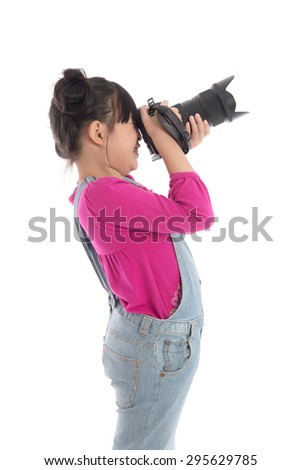 Cute asian girl holding  camera on white background isolated