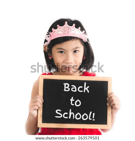 Cute Asian girl in red dress holding Back to school blackboard isolated on white. - stock photo