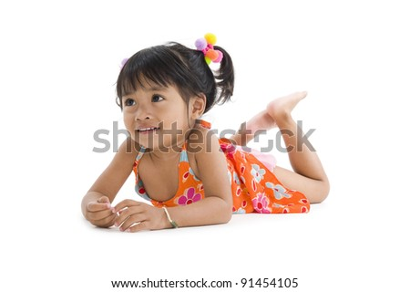 cute asian girl laying on the floor - stock photo
