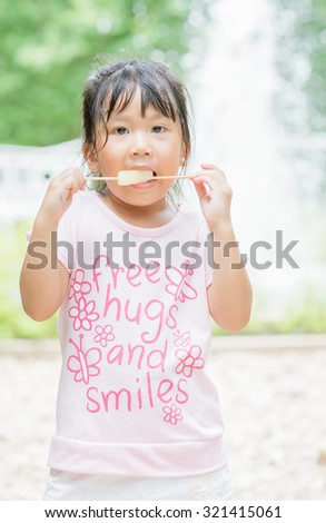 Cute asian girl like to eating an ice-cream - stock photo