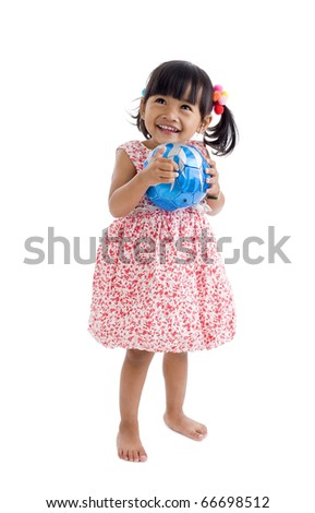 cute asian girl with a football, isolated on white background