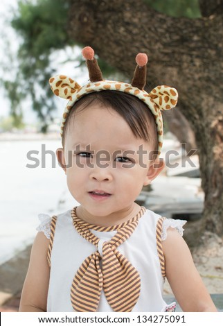 Cute asian girl with hair band portrait.