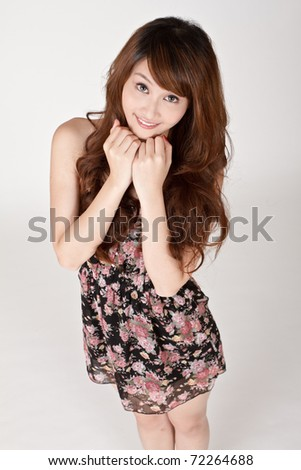 Cute Asian girl with happy smiling expression, closeup portrait. - stock photo