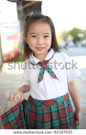 cute asian girl with smiling face in town background - stock photo