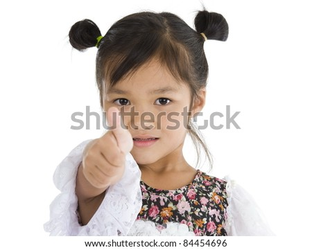 cute Asian girl with thumb up over white background - stock photo