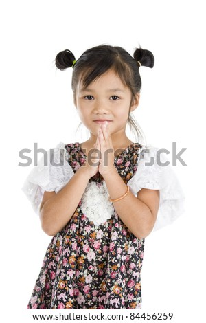 cute Asian girl with welcome gesture over white background - stock photo