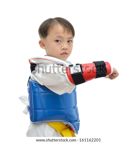Cute asian teakwondo boy on white background. - stock photo