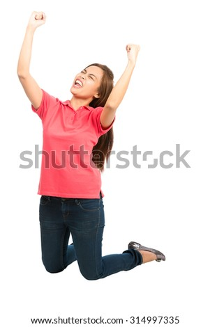 Cute asian woman casual clothes kneeling, arms extended punching air, pumping fists cheering, celebrating favorite sports team goal, touchdown, score, win while looking up and away from the camera