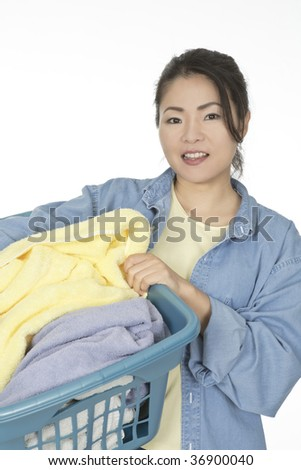 Cute Asian woman holding a basket of laundry - stock photo