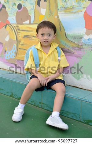Cute asian young boy in the school.