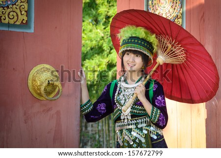 cute asian young girl in beautiful hill tribe (HMONG) costume of northern thailand - stock photo