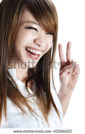 Cute asian young woman showing the peace / victory hand sign. - stock photo