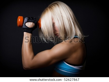 Cute athlete holding her weights - stock photo