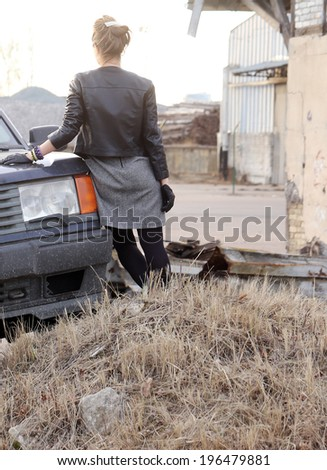 Cute, attractive girl by the car