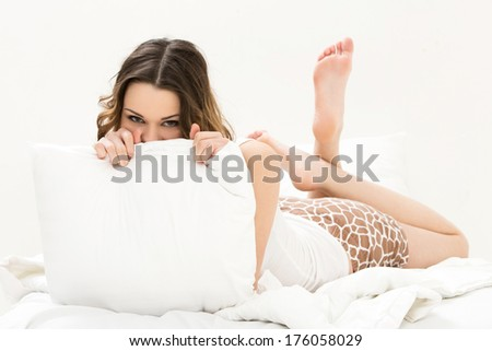 Cute, attractive girl in the bed