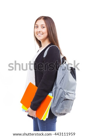 Cute attractive student girl holding colorful notebooks, isolated on white background - stock photo