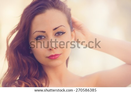 Cute, attractive woman, close up photo with color filters, glow effects, and some fine film grain added - stock photo