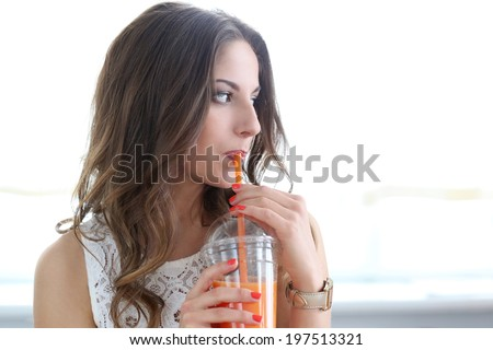 Cute, attractive woman with orange juice - stock photo