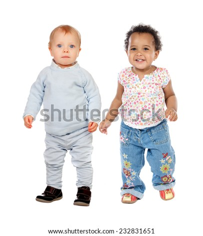 Cute babies standing isolated on white background - stock photo