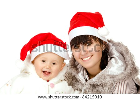 cute baby and a young girl with santa hats, isolated on white background - stock photo