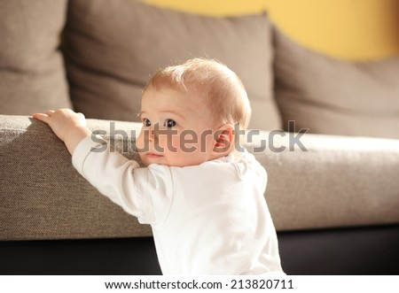 Cute baby at bad in room - stock photo