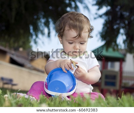 Cute baby at the playground - stock photo