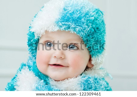 Cute baby at winter background - stock photo