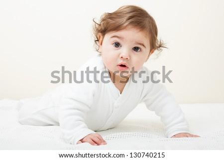 Cute Baby boy crawling on knitted blanket