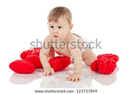 Cute baby boy holding a heart-shaped balloon - stock photo