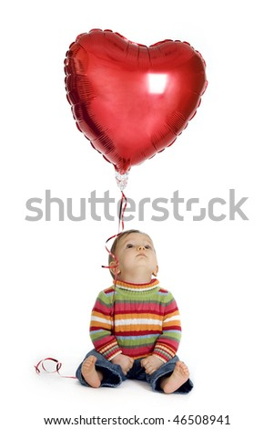 Cute baby boy holding a heart-shaped balloon - stock photo
