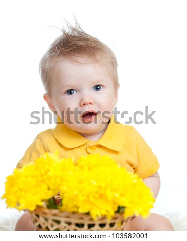 cute baby boy holding basket with yellow flowers - stock photo