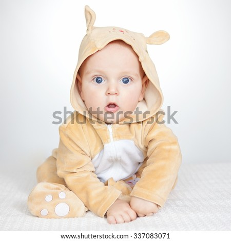 cute baby boy in funny deer costume on white background - stock photo
