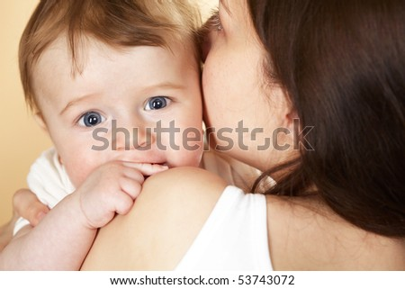 cute baby boy in mothers arm - stock photo