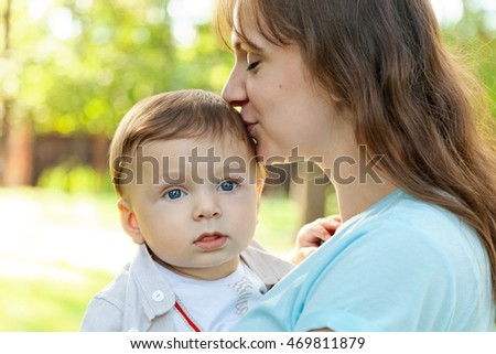 Cute baby boy infant  with his mom in summer park